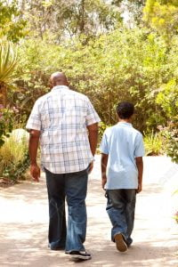 African American father and son taking a walk.